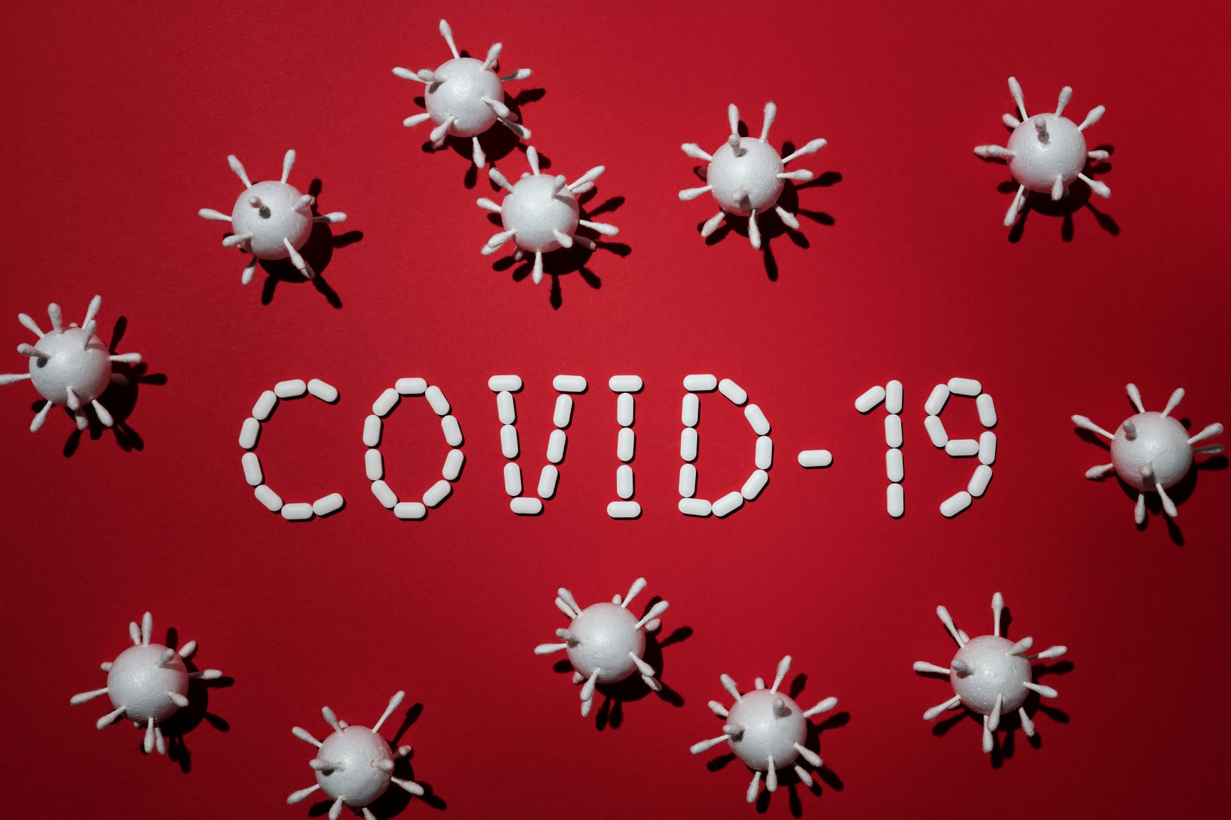 Canva - Concept Of Covid-19 In Red Background 2 Photo by Edward Jenner