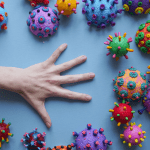 Hand surrounded by virus